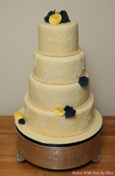 4 tier wedding cake handmade roses.jpg